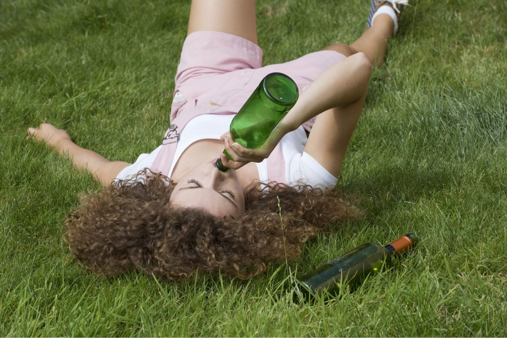 Woman Drinking Wine Being Publicly Intoxicated